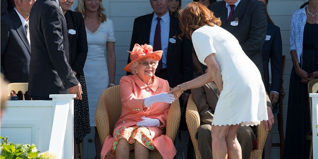 Susan Sarandon introduced herself to Queen Elizabeth at the Royal Windsor Cup polo match held at the Guards Polo Club in Egham, England on June 24.