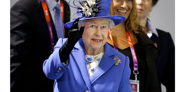 July 28, 2012: Queen Elizabeth II waves to spectators inside the Aquatics center at the 2012 Summer Olympics.