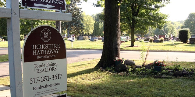 """A home for sale near a cemetery advertises it has """"quiet neighbors"""""""