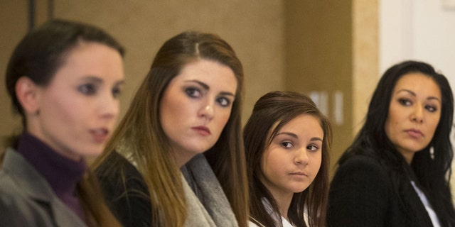 From the left; Rachael Denhollander, Sterling Riethman, Kaylee Lorincz, Jeanette Antolin and Tiffany Thomas appear at a press conference after Larry Nassar was sentenced to 60 years in prison on child pornography charges in Grand Rapids, Mich., on Thursday, Dec. 7, 2017. The women are some of the many former patients of Nassar who have accused him of molestation. Nassar was convicted of possessing child pornography and assaulting gymnasts.