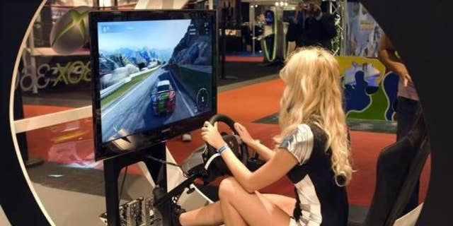 Sept. 17, 2009: A hostess plays a car racing game during the video game show in Paris.