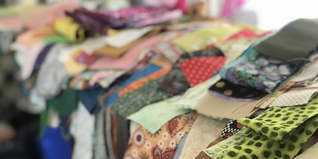 Hundreds of pieces of scrap fabric have been donated to Heft's church to be used to make quilts and dresses for children.