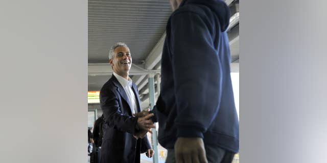 Former White House chief of staff Rahm Emanuel greets commuters at a downtown train station as he campaigns for Chicago mayor on Monday, Oct. 4, 2010 in Chicago. (AP Photo/Chicago Sun-Times, Brian Jackson)