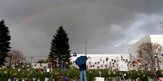 """A rainbow appears over Paisley Park near a memorial for Prince, Thursday, April 21, 2016, in Chanhassen, Minn. Prince, widely acclaimed as one of the most inventive and influential musicians of his era with hits including """"Little Red Corvette,"""" ''Let's Go Crazy"""" and """"When Doves Cry,"""" was found dead at his home at Paisley Park on Thursday, according to his publicist. He was 57. (Carlos Gonzalez/Star Tribune via AP)"""