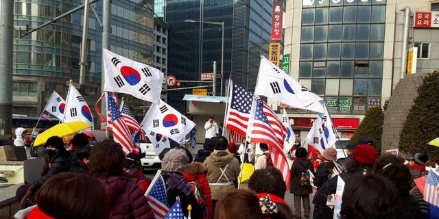 South Korean and American flags are waved at rallies against the current South Korean government, led by Moon Jae-in.