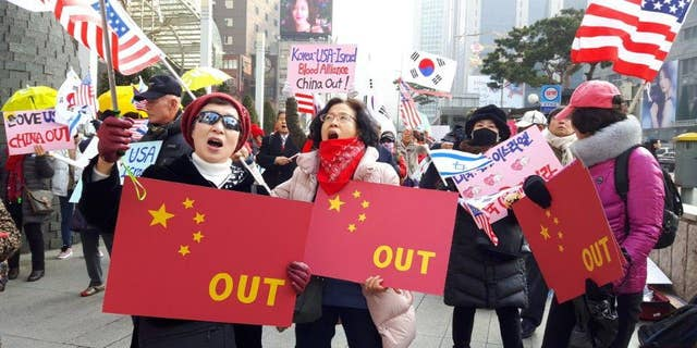 Conservative activists call for a cooling of relations with China.