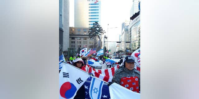 Israeli and American flags are often a staple at pro-Park rallies across South Korea.
