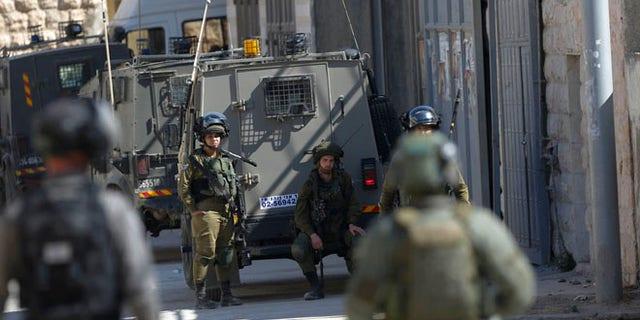 Israeli security forces raid the West Bank village of Deir Abu Mash'al near Ramallah, Saturday
