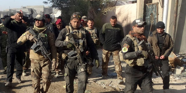 Dec. 28, 2015: Iraqi security forces enter the government complex in central Ramadi, 70 miles west of Baghdad, Iraq. (AP)