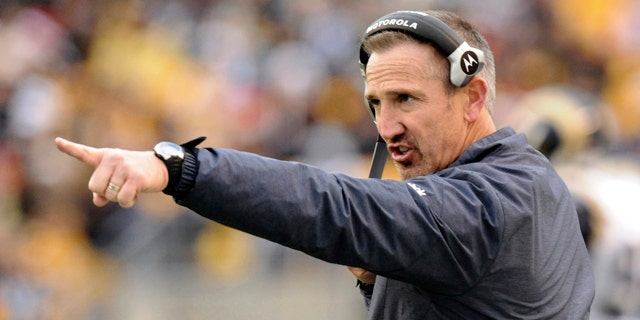 Dec. 24, 2011: St. Louis Rams head coach Steve Spagnuolo points onto the field as his team plays against the Pittsburgh Steeler in an NFL football game in Pittsburgh.