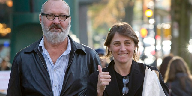 """FILE - This Oct. 27, 2010 file photo shows, actor Randy Quaid, left, and his wife Evgenia outside their lawyer's office in Vancouver. Quaid and his wife sued John Kerry and the State Department on Monday, Dec. 15, 2014, to recover passports that the government revoked three years ago. The actor said the revocation involved an issue over """"an insurance policy that we did not take out,"""" but declined to discuss it further."""