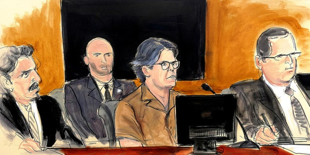 In this courtroom sketch Keith Raniere, second from right, leader of the secretive group NXIVM, attends a court hearing Friday in the Brooklyn borough of New York.