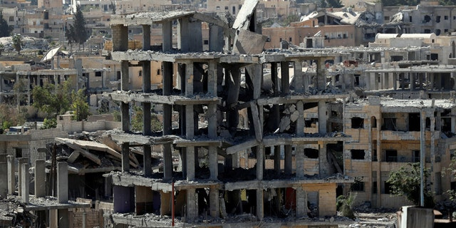 A view of destroyed buildings at the frontline in Raqqa, Syria.