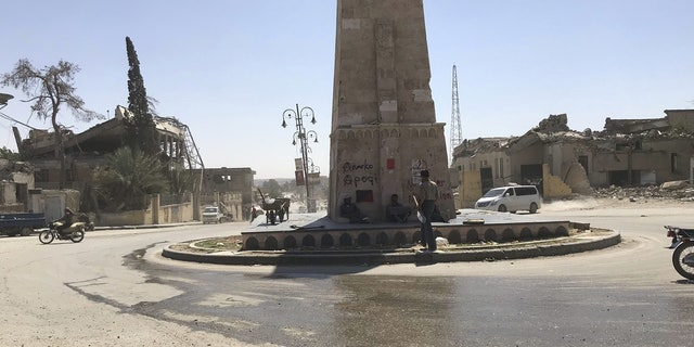Signs of ISIS graffiti and brutality plague Raqqa's city center