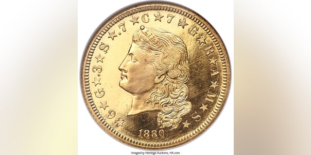 "This undated image provided by Heritage Auctions shows an 1880 $4 gold piece called a ""Flowing Hair Stella,"" considered one of the great rarities in America gold coins. The coin sold at auction for $750,000 during the annual Florida United Numismatists Convention, in Tampa, Fla., on Thursday, Jan., 4, 2018. (Heritage Auctions via AP)"