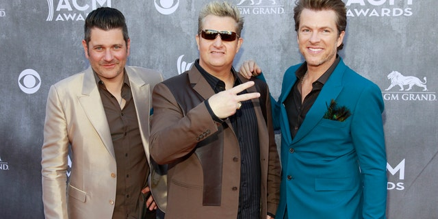 (L-R) Jay DeMarcus, Gary LeVox and Joe Don Rooney of the group Rascal Flatts . This week LeVox raised eyebrows for bringing attention to a conspiracy theory about the Christmas Day bombing in Nashville.