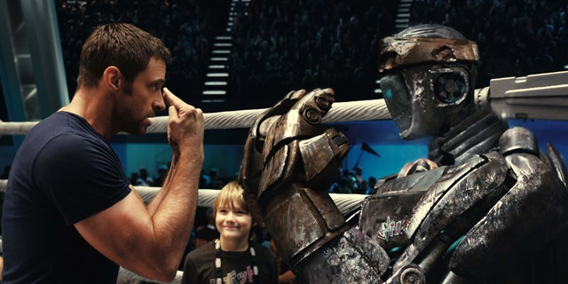Hugh Jackman, left, and Dakota Goyo are shown in a scene from 'Real Steel.'