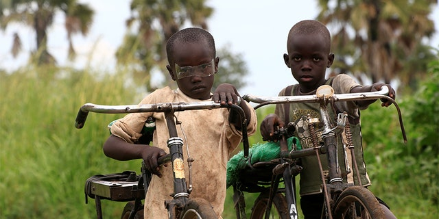 Refugee children from South Sudan ride their bicycles at Palorinya settlement in Moyo district northern Uganda October 25, 2017