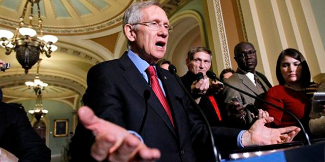 Senate Majority Leader Harry Reid gestures during a news conference on Capitol Hill Dec. 8. (AP Photo)