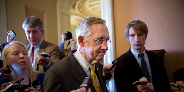 FILE: Dec. 30, 2012: Senate Majority Leader Harry Reid walks to meeting on Capitol Hill, in Washington, D.C.