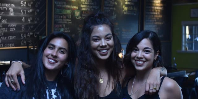 "Attendees are seen at the ""Reparations Happy Hour"" in Portland, Oregon."