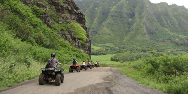 Taking an ATV tour of Kualoa Ranch.