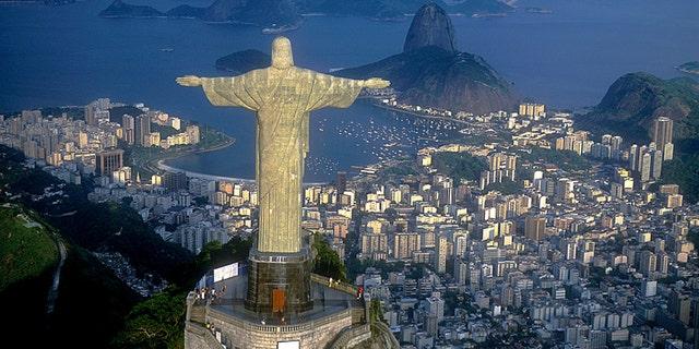 Christ, symbol of Rio de Janeiro, standing on top of Corcovado Hill, overlooking Guanabara Bay, Rio de Janeiro, Brazil