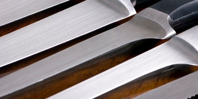 A close up shot of high quality kitchen knives on a cutting board