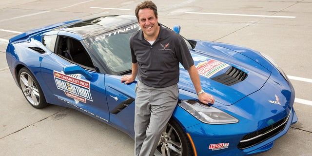 Mark Reuss with the 2013 Chevrolet Corvette Stingray pace car prior to driving it at the 2015 Iindycar Detroit Grand Prix
