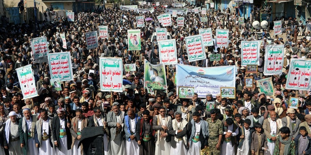 """Followers of the Houthi movement rally to mark the 'Martyr Day' in Saada, Yemen February 5, 2018. The placards read: """"Allah is the greatest. Death to America, death to Israel, a curse on the Jews, victory to Islam."""" REUTERS/Naif Rahma - RC19C29CE220"""