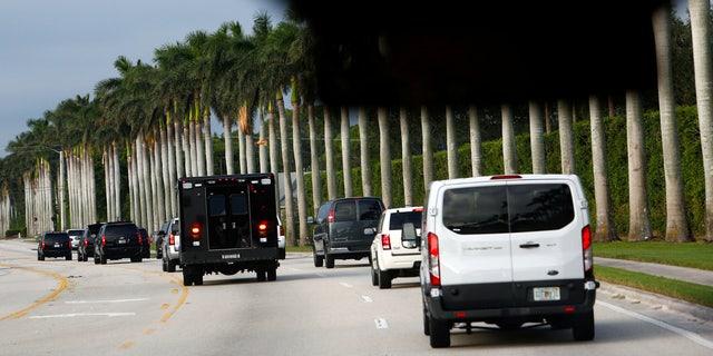 President Trump's motorcade arrives at the Trump International Golf Club in West Palm Beach, Fla. Saturday afternoon.
