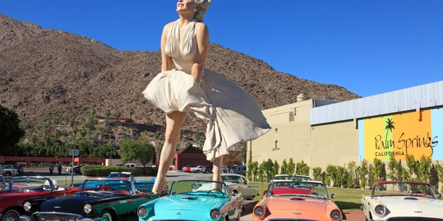 Public Square downtown Palm Springs with Marilyn Monroe scupture and early model convertibleThunderbirds. Brilliant blue Palm Springs Sky in the background.  All from the same era.  Marilyn is the most popular tourist attraction in the town.