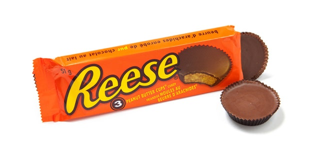 Toronto, Canada - May 10, 2012: This is a studio shot of Reese Peanut Butter Cups candy made by Reese, a subsidiary of The Hershey Company, isolated on a white background.