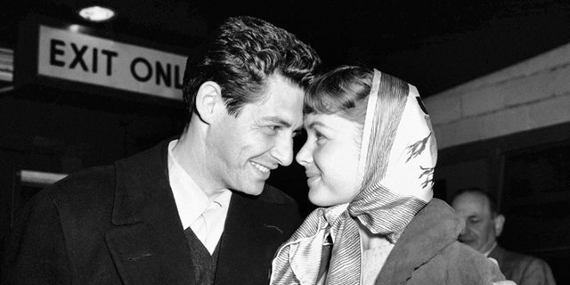 Singer Eddie Fisher and actress Debbie Reynolds, have eyes only for each other at Idlewild Airport, April 19, 1955, in New York after arriving from England.