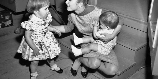 "Debbie Reynolds is visited at the studio of ""Say One For Me"" by her children, Carrie 2½, and one-year-old Todd on Feb 27, 1959.  (AP Photo)"