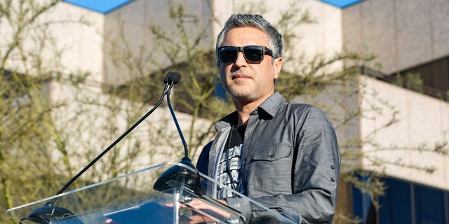 """Reza Aslan speaks at the UTA """"United Voices"""" Rally at United Talent Agency headquarters on Friday, Feb. 24, 2017, in Beverly Hills, Calif. He is the host of the new CNN show """"Believer."""""""