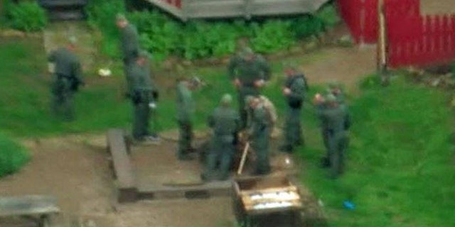 SWAT team searched a farm in Adams County Friday in connection with the Rhoden family murder probe.