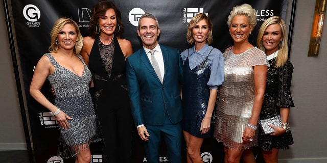 The cast with of the 'RHONY' pose at their premiere event with Andy Cohen.