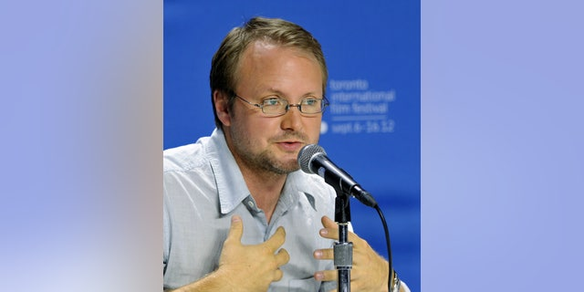 """September 6, 2012. Director Rian Johnson speaks during the news conference for the film """"Looper"""" at the 37th Toronto International Film Festival."""