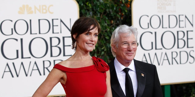 Actor Richard Gere and his wife, Carey Lowell, arrive at the 70th annual Golden Globe Awards in Beverly Hills, California, January 13, 2013.