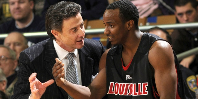 Louisville coach Rick Pitino, left, talks with guard Andre McGee during the first half of an NCAA college men's basketball game against Notre Dame in South Bend, Ind. Feb. 12, 2009.