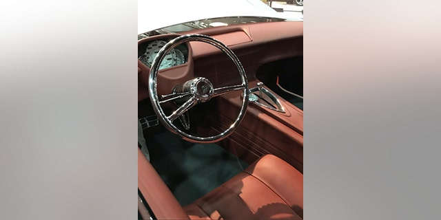 The 150's ho-hum interior has been given a sleek, retro-futuristic overhaul crowned by a chrome steering wheel.