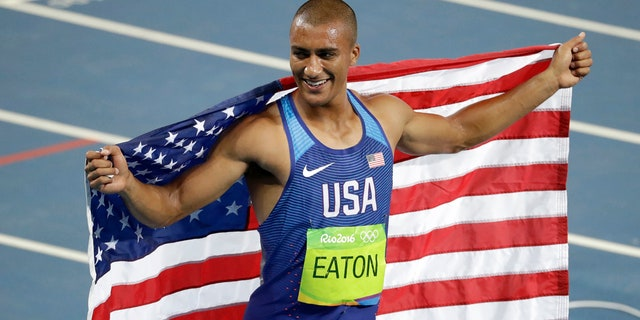 Aug. 18, 2016: United States' Ashton Eaton celebrates winning the gold medal in the men's decathlon during the athletics competitions of the 2016 Summer Olympics at the Olympic stadium in Rio de Janeiro, Brazil.