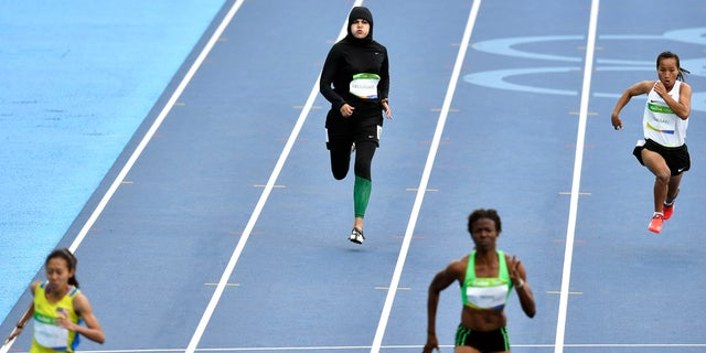 Aug. 12, 2016: Saudi Arabia's Kariman Abuljadayel competes in a women's 100-meter heat during the athletics competitions of the 2016 Summer Olympics at the Olympic stadium in Rio de Janeiro, Brazil.