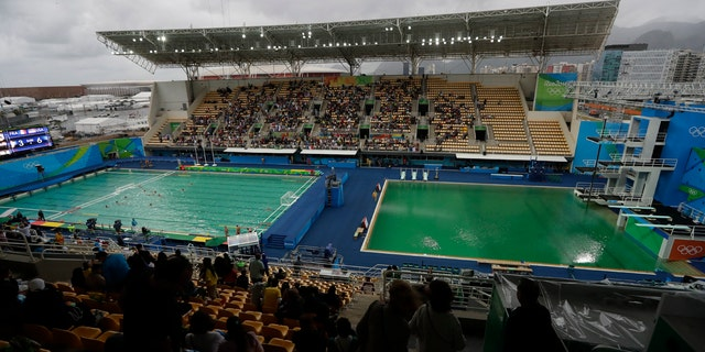 In this Aug. 10, 2016 file photo, the water of the diving pool at right appears a murky green.