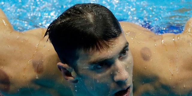 United States' Michael Phelps leaves the pool after winning a heat of the men's 200-meter individual medley during the swimming competitions at the 2016 Summer Olympics, Wednesday, Aug. 10, 2016, in Rio de Janeiro, Brazil. (AP Photo/Matt Slocum)