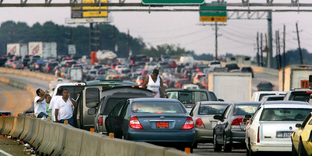 Thousands of cars try to evacuate to Dallas in advance of Hurricane Rita in north Houston September 22, 2005.