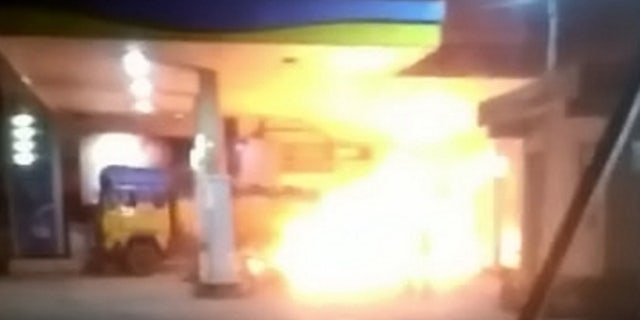 The truck was engulfed in huge flames as Khan drove it from the station.