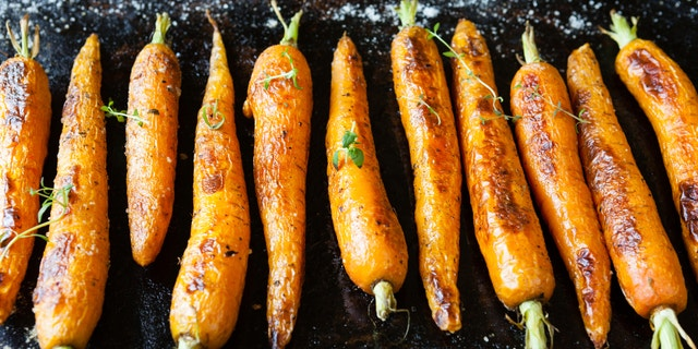 whole roasted carrots with tails, food close up