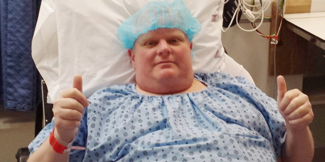 FILE - In this Monday, May 11, 2015 photo provided by Dan Jacobs, former Toronto Mayor Rob Ford gives a thumbs up before surgery in Toronto, to remove a cancerous tumor from his abdomen. On Thursday, March 17, 2016, Ford's chief of staff, Jacobs, said doctors are working on building his strength to be able to resume chemotherapy. In October 2015, doctors also discovered two cancerous growths on his bladder. He has been in the hospital since late February. (Courtesy Dan Jacobs via AP)